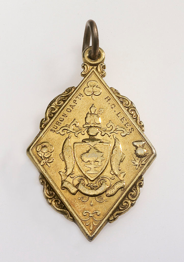 Detail of Flat, gilt metal diamond-shaped pendant by unknown