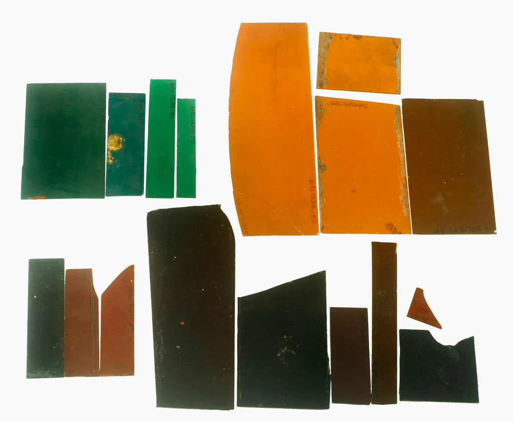Detail of Eighteen pieces of coloured glass (five amber, three crimson, four dark green, six purple) in a bag by unknown