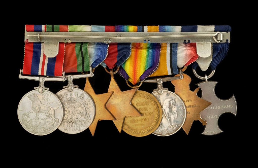 Detail of Medals awarded to Cdr J. L. Younghusband DSC (reverse, r to l, MED1228-1235) by Garrard & Co.
