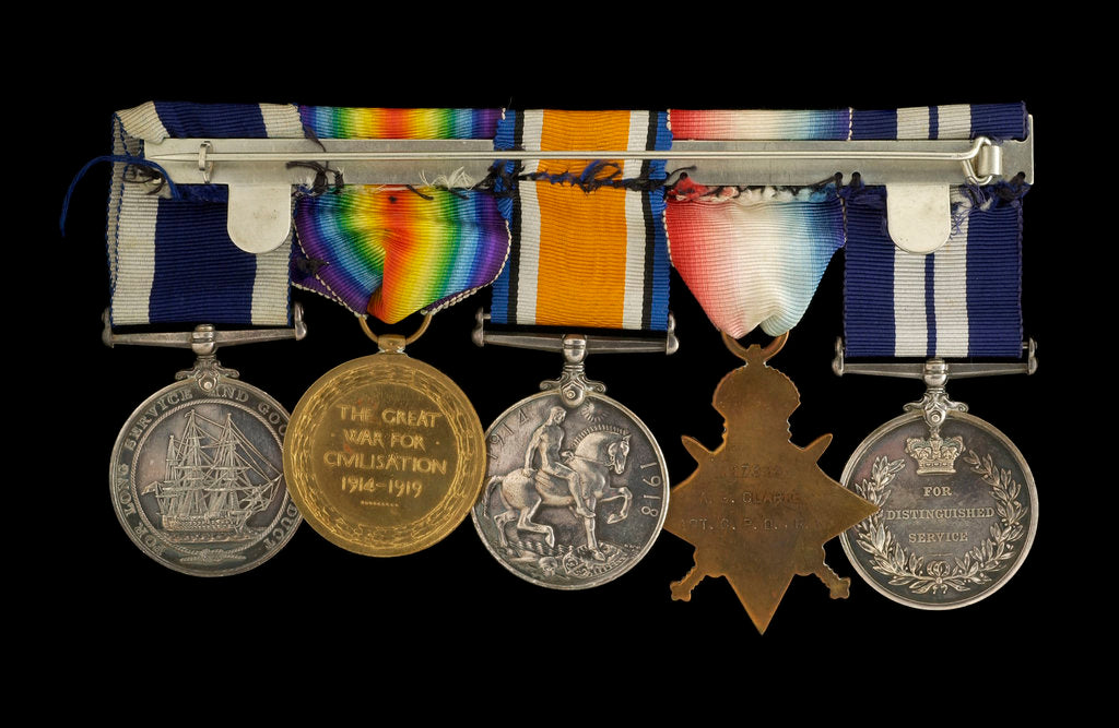 Detail of Medals awarded to Chief Petty Officer A. G. Clarke DSM (reverse, r to l, MED1095-1104) by B. Mackennal
