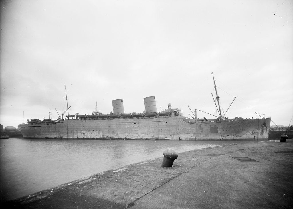 Turbine passenger liner 'Mauretania' (Br, 1939) at quayside, probably at Liverpool with Radar lantern fitted by Anonymous