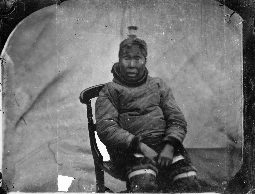 Detail of An elderly Inuit woman seated in chair by Edward Augustus Inglefield
