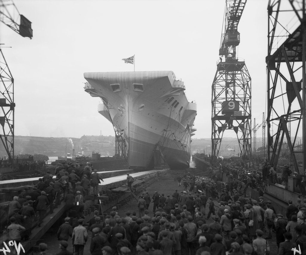 Detail of Aircraft carrier HMS 'Victorious' (1939) moving down the slipway on No.3 berth by unknown