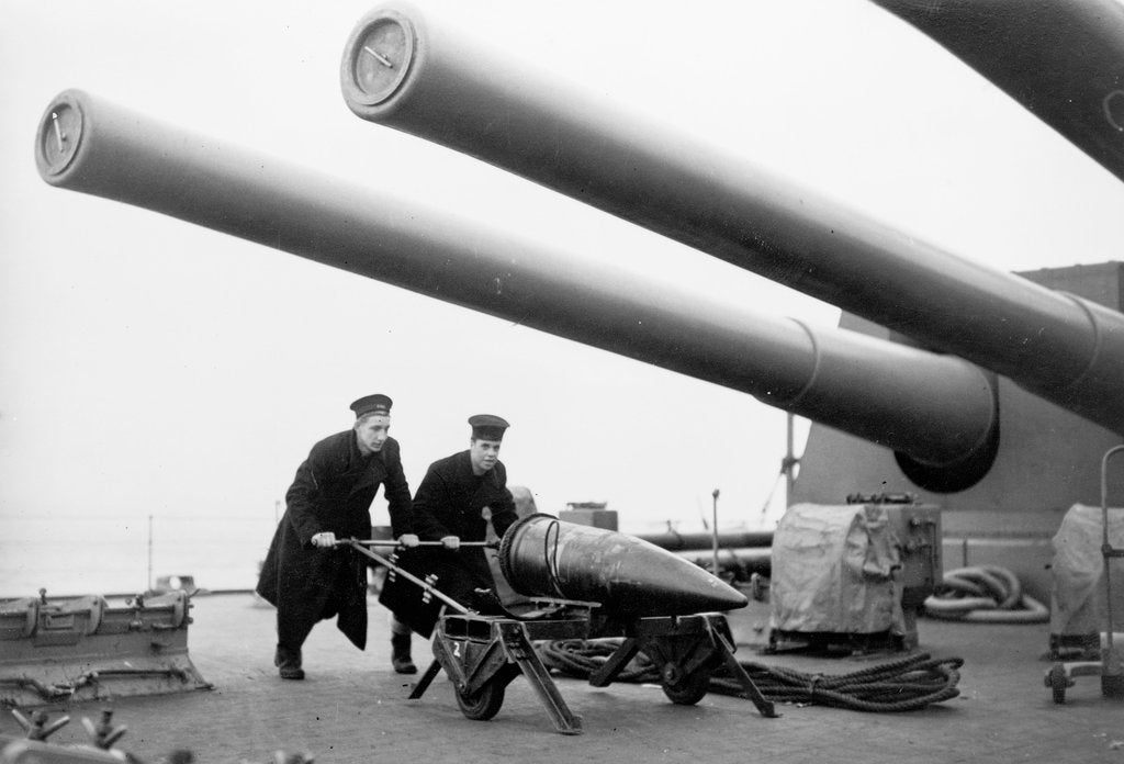 Detail of Two ratings pushing a 14-inch shell on a trolley on the battleship 'King George V' (1939). King George V carried about 800 shells for her 10 guns when loaded. by unknown