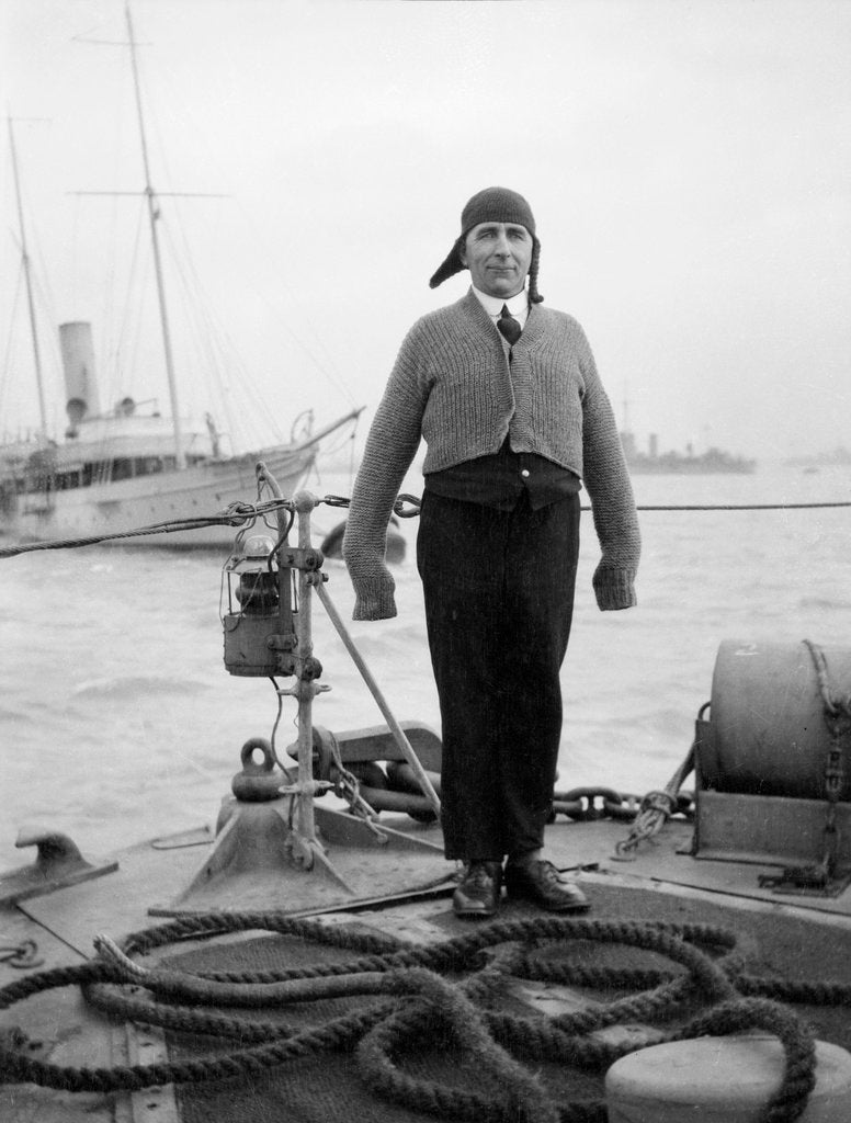 Detail of Gunner William G. Worsh of the destroyer 'Swallow' proudly showing off his latest comforts from home, a hand-knitted cardigan and balaclava by unknown