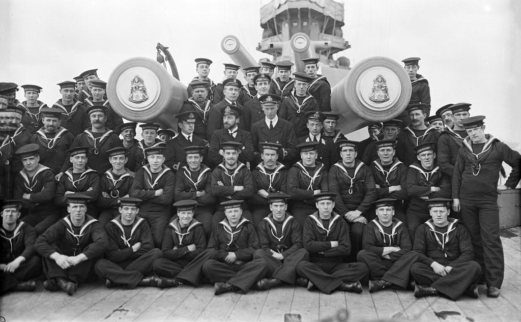 Detail of The gun crew of 'A' turret on the forecastle with the barrels of the turret projecting through the group of 'Queen Elizabeth' (1913) by unknown