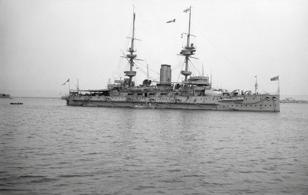 Detail of HMS 'Caesar' (1896), battleship, at anchor, awning rigged aft by unknown