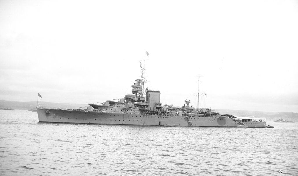 Detail of Light cruiser HMS 'Effingham' (1921) in 1939 at anchor with awning rigged aft by unknown