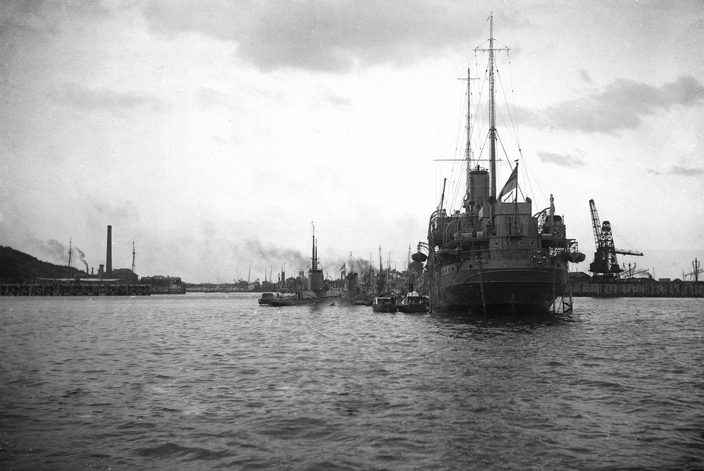 Detail of HMS 'Titania' (1915) submarine depot ship, moored at Portland with 4 submarines alongside by unknown