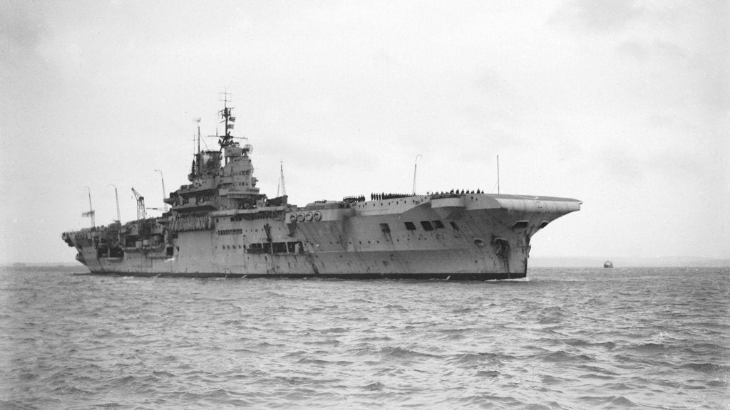 Aircraft carrier HMS 'Indomitable' (1940), under way, approaching Portsmouth harbour by Anonymous