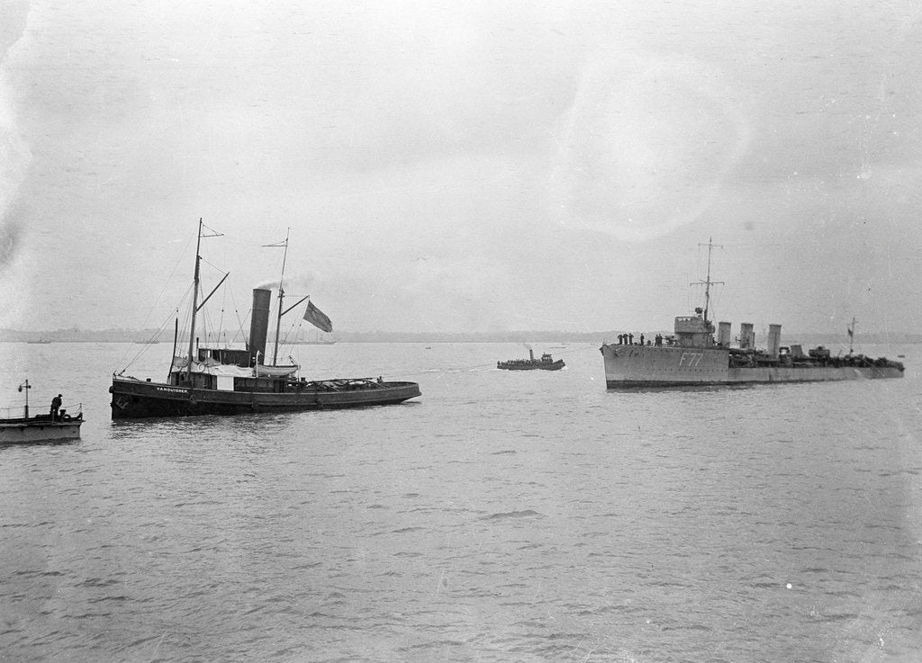 Detail of Rescue tug HMS 'Vanquisher' (1899) entering the floating dock at Harwich with the mined destroyer 'Thisbe' (1917) in tow by unknown