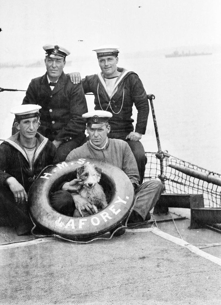 Detail of Photograph of four petty officers on board 'Laforey' (1913) at Harwich in 1915-1916 with the ship's dog mascot by unknown