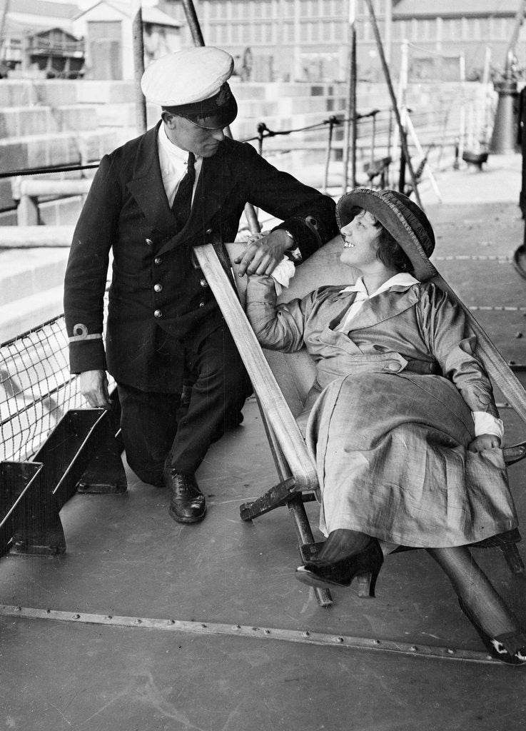 Detail of HMS 'Laforey' (1913), a couple on the ship, in dry dock by unknown