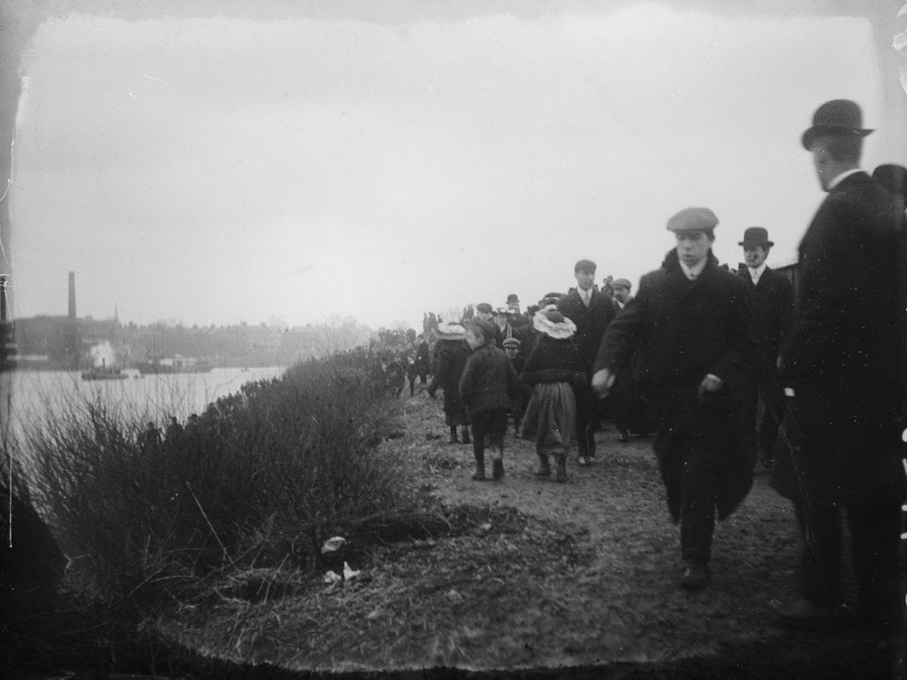 Detail of Spectators on the tow path on the south bank of the Thames near Hammersmith Bridge on Boat Race Day, 1907 by unknown