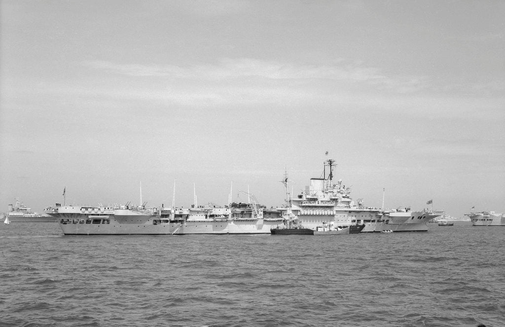 Detail of Aircraft carrier HMS 'Illustrious' (1939) in June 1953, anchored in Line F at Spithead for the Coronation Review. The aircraft lighter 'R.N.AIR' is alongside by unknown