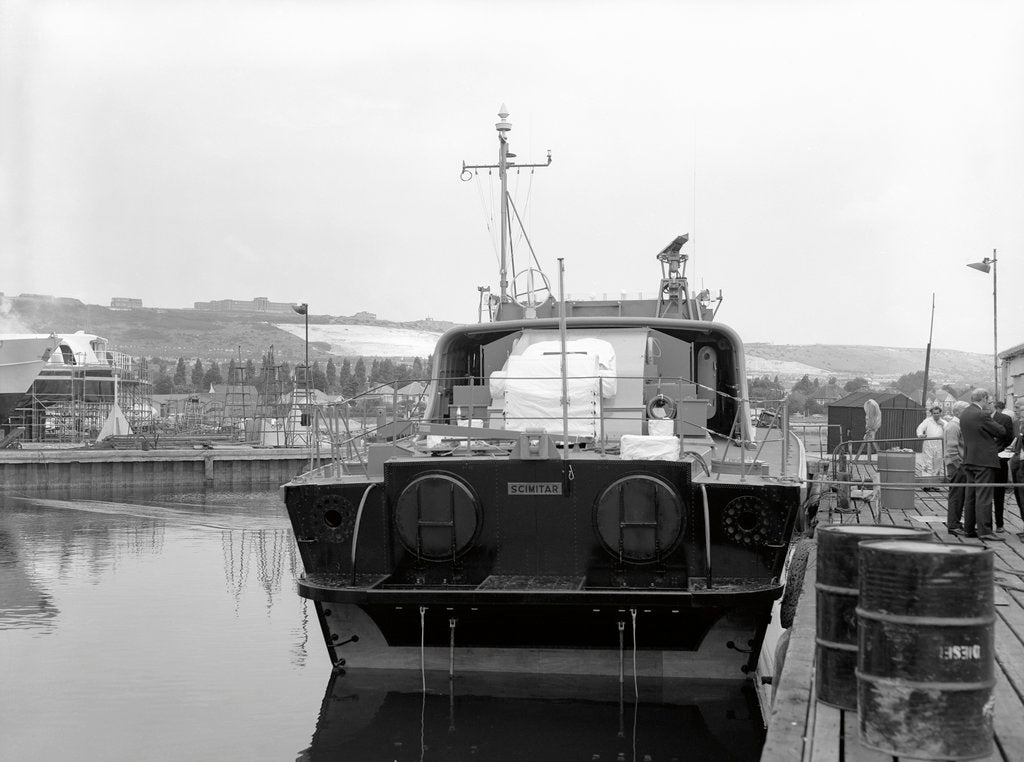 Detail of HMS 'Scimitar' (1969), fast training boat, alongside in the fitting out basin at Vosper's Portchester shipyard by unknown