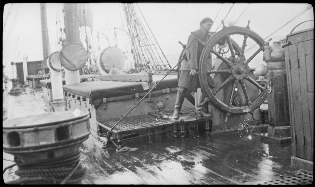 The 'Herzogin Cecile' (Fi, 1902) a seaman at the midships wheel in heavy weather. The helmsman is wearing a safety harness by unknown