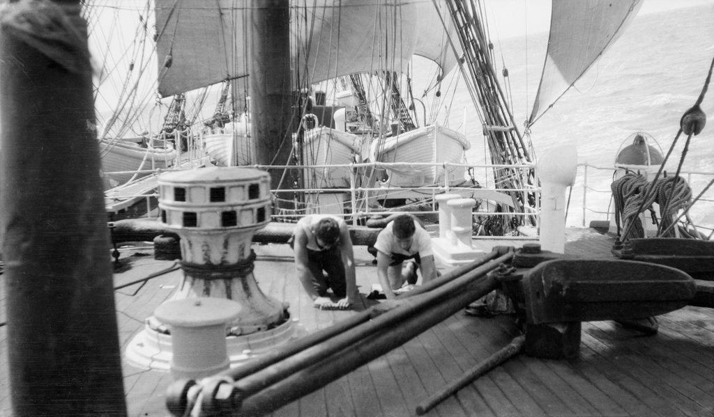 Detail of 'Herzogin Cecilie' (launched 1902) under sail, two seamen are holystoning the deck, 1928 by Gustaf Erikson