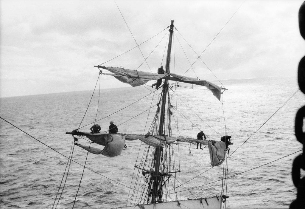 Detail of Aloft on the Mizzen furling the blown-out sails by Alan Villiers