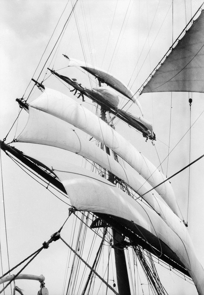 Detail of High aloft, taking in sail as the storm increases by Alan Villiers