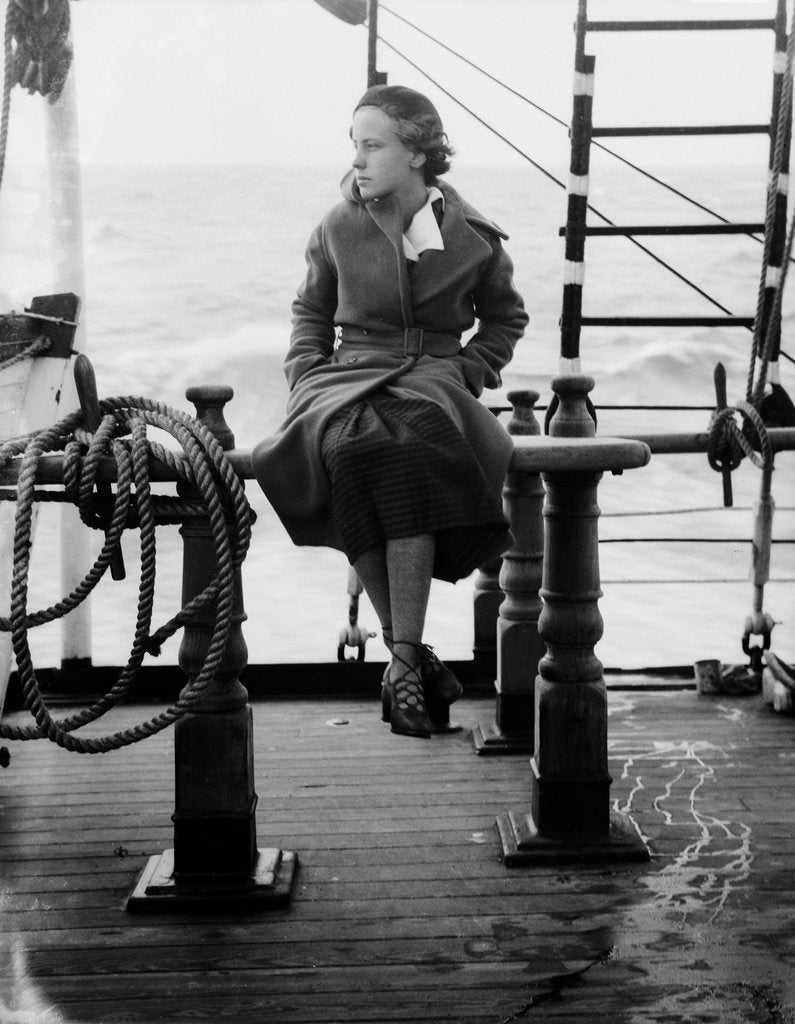 Detail of Elisabeth Jacobsenin shore clothes seated on the poop rail, aboard 4 masted barque 'Parma' (Fi, 1902), ex 'Arrow' (Ruben de Cloux) by Alan Villiers