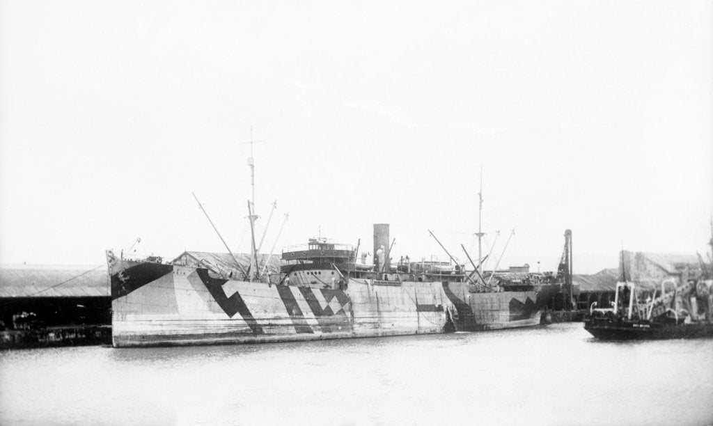 Detail of General cargo ship 'Vestalia' (Br, 1912) S. S. Co Ltd (Gow Harrison & Co), at quayside, camouflaged by unknown