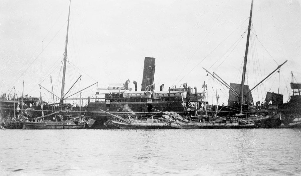 Detail of 'Sakura Maru' (Ja, 1887) at moorings, junks alongside by unknown