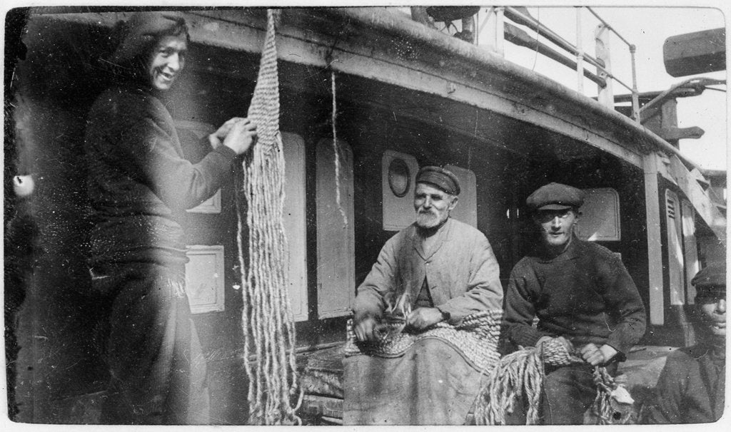 Detail of Apprentice Williams and others making sennit mats aboard 3 masted ship 'Zealandia' (Br, 1869), Shaw, Savill & Albion Co Ltd by unknown
