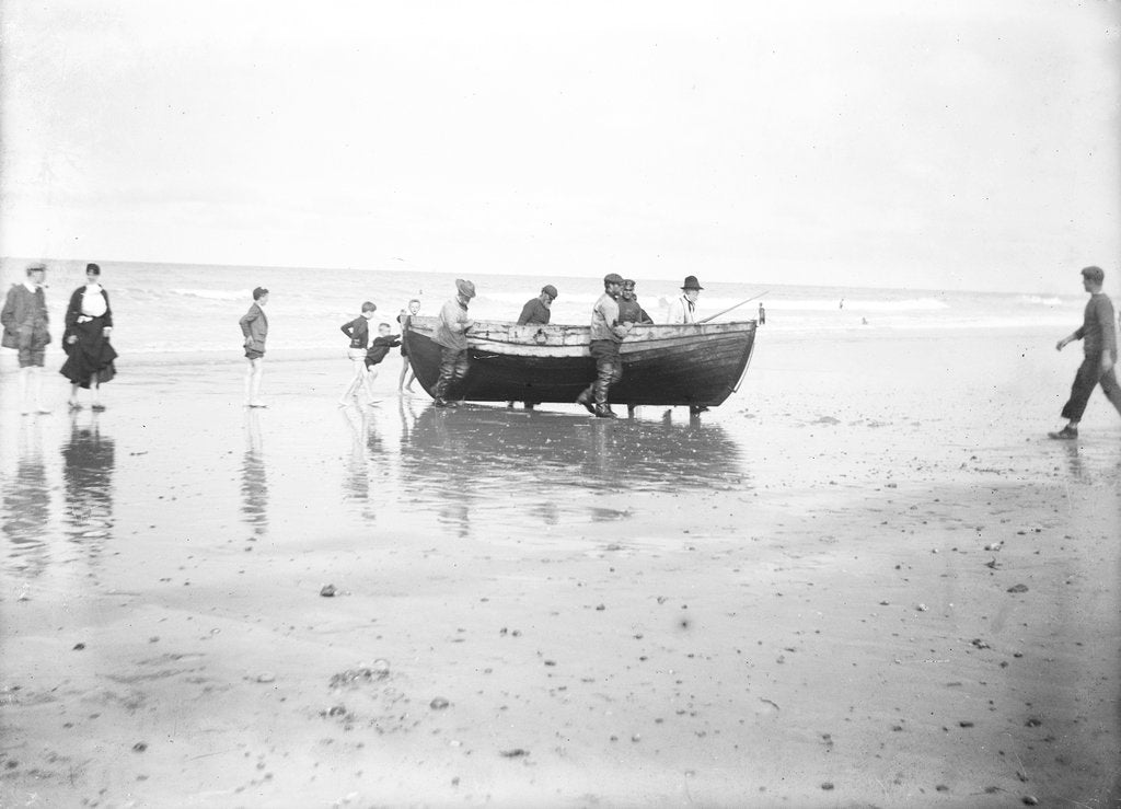 Detail of Five fishermen carrying a Sheringham crab boat up the beach, assisted by three boys, at Lowestoft by Smiths Suitall Ltd.