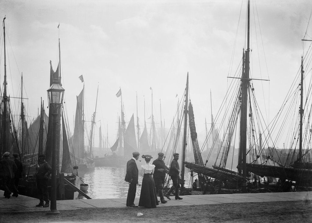 Detail of Trawlers berthed in the outer harbour with the morning mist rising at Lowestoft, Suffolk by Smiths Suitall Ltd.
