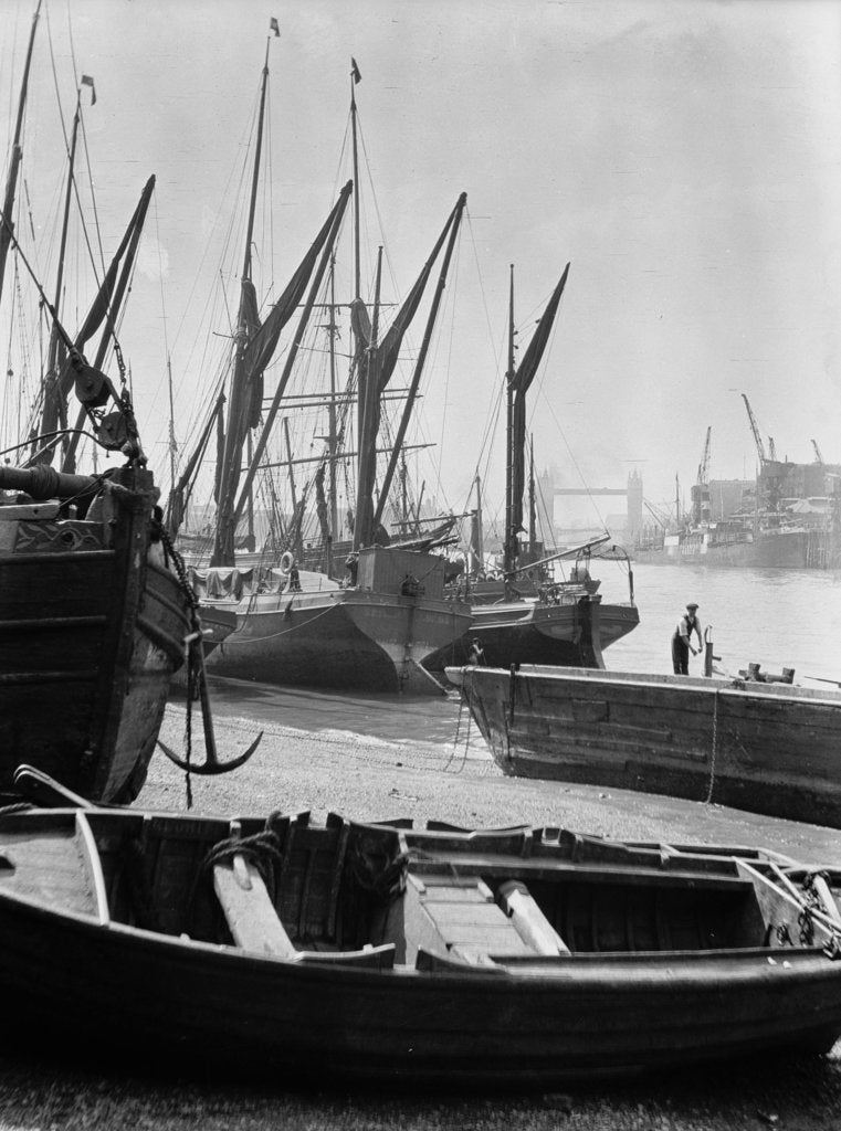Detail of The Thames at low water with various crafts beached on the Southbank and Tower Bridge in the background. by Eagar