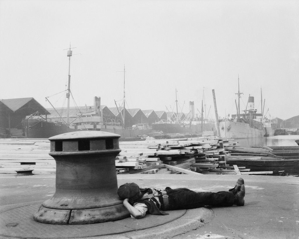 Detail of Man resting at Surrey Commercial Docks by unknown