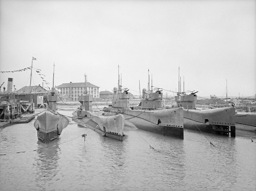 Detail of HMS Submarine 'L71' (1919), berthed at HMS 'Dolphin', Haslar Creek, with 'L56' (1919) and 'L53' (1919) inboard and 'L69' (1918) and 'L21' (1919) outboard by unknown