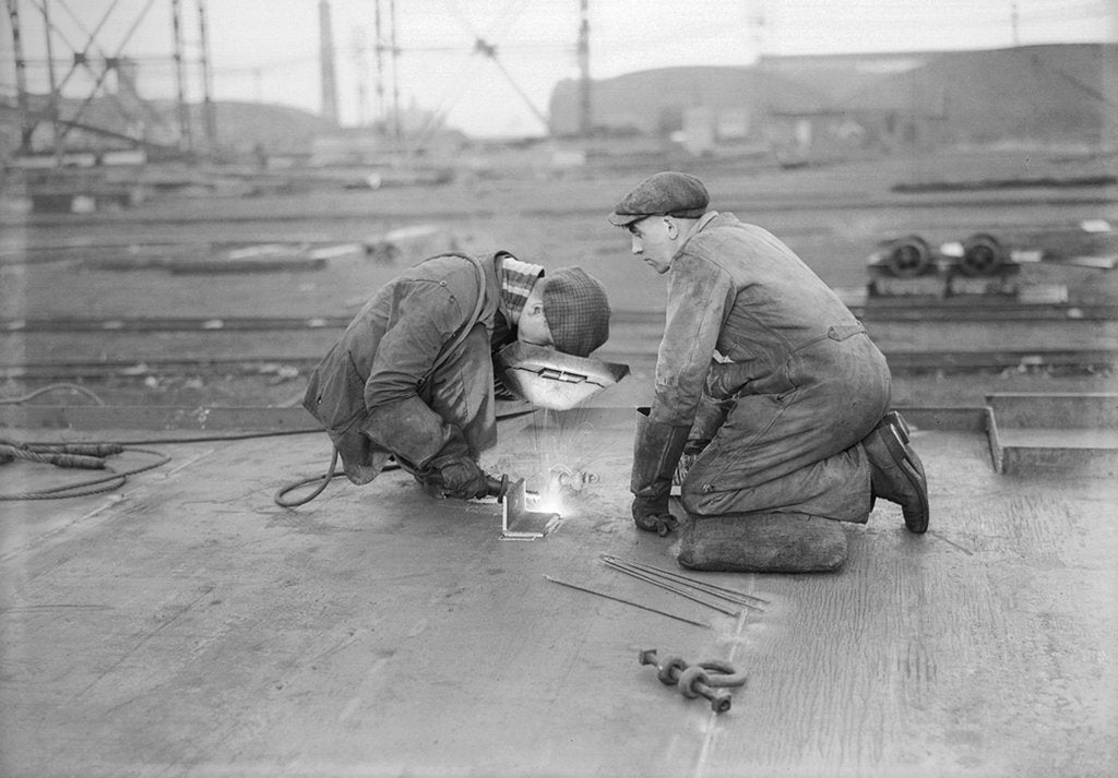 Detail of Robert the Bruce. Two welders at work aboard the vessel. by unknown