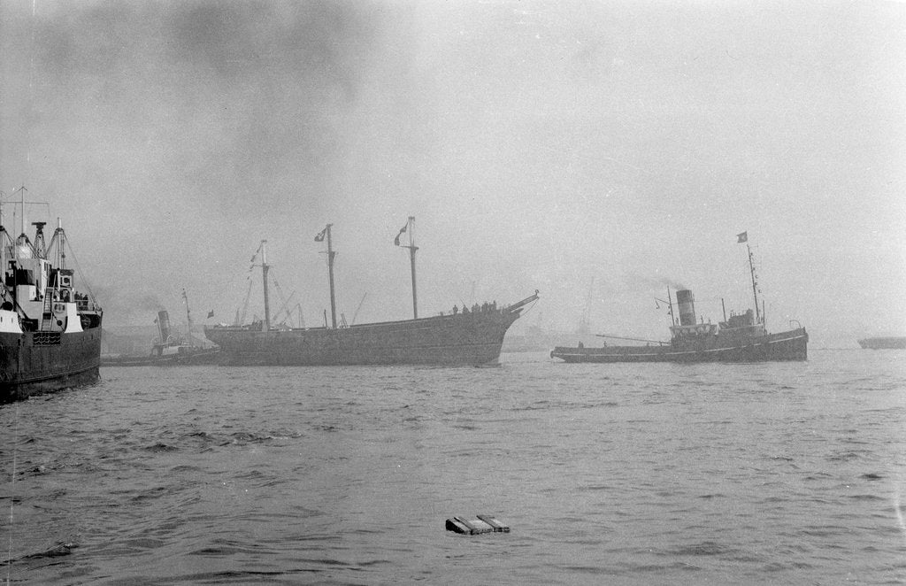 Detail of The clipper ship 'Cutty Sark' (1869) being towed from the East India Dock to Greenwich by the tug 'Gondia' (1927) by unknown