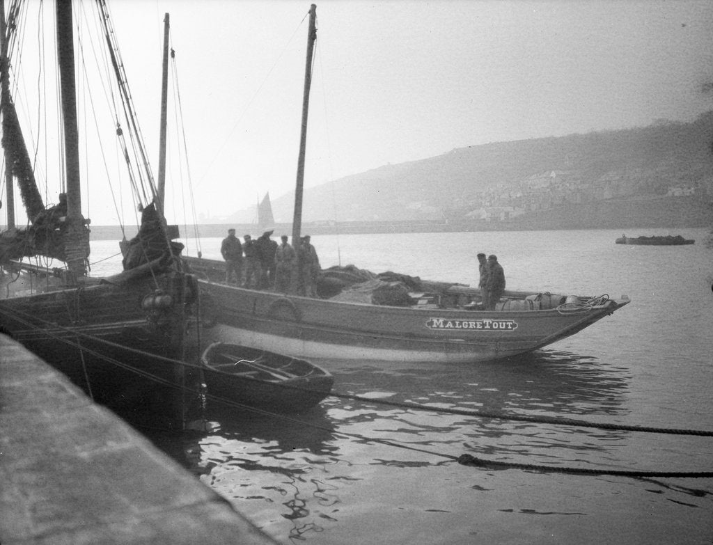 Detail of 'Malgre Tout' (Fr, 1920s) moored at quayside, Newlyn, bows obscured by unknown