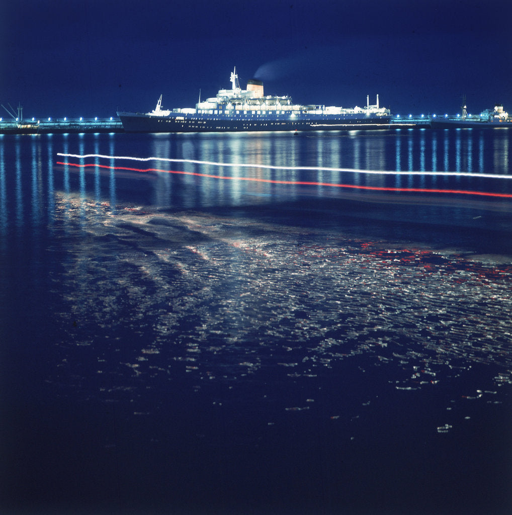 Detail of A night shot of an unspecified cruise liner under way by Marine Photo Service