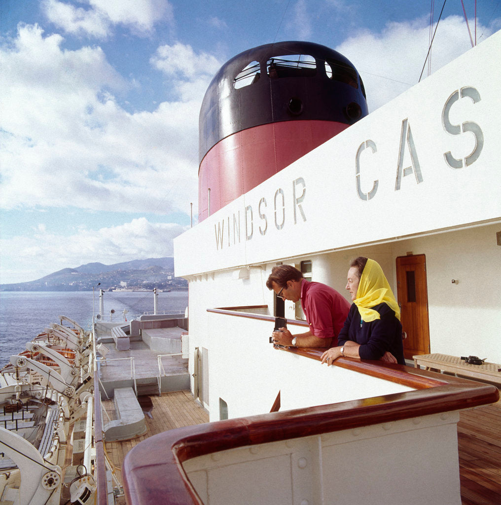 Detail of Two passengers enjoy the view from the upper deck of Union-Castle liner 'Windsor Castle' by Marine Photo Service