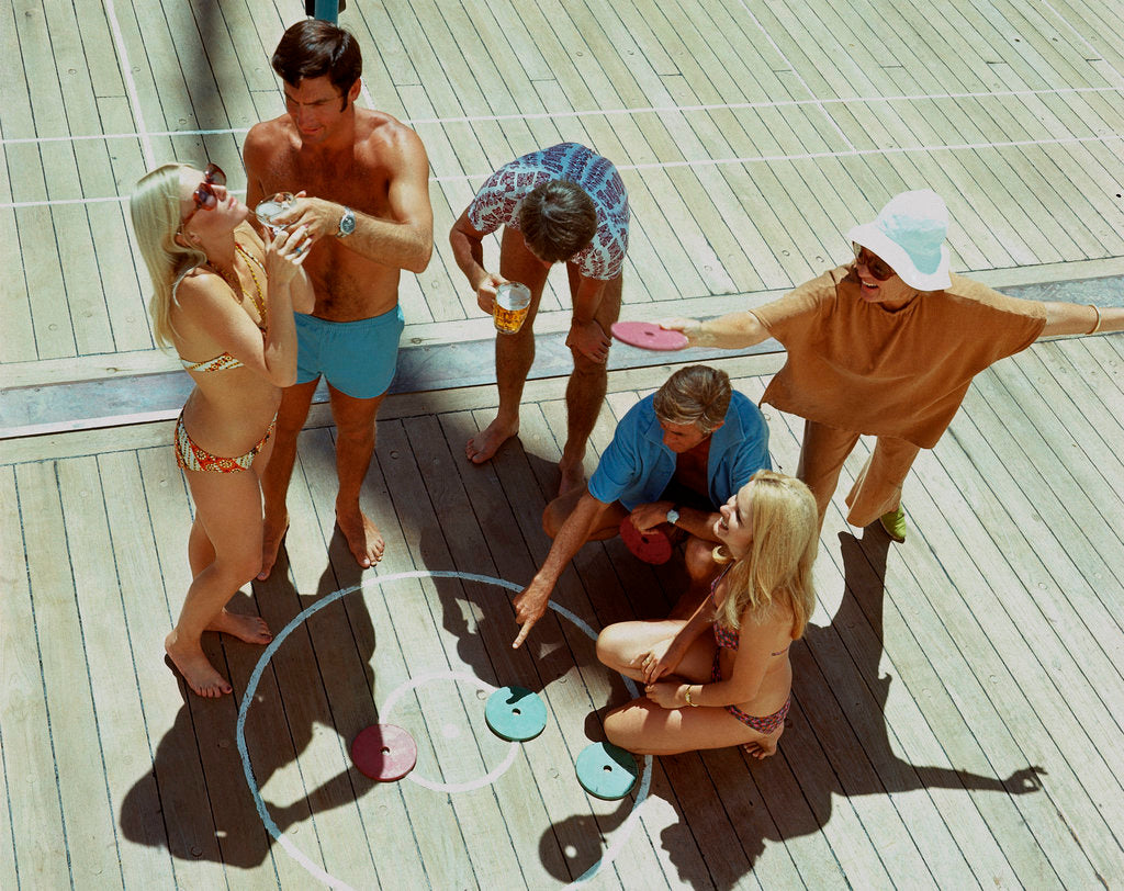 Detail of A group of passengers aboard an unspecified cruise ship enjoy a game of deck quoits by Union Castle Line Collection