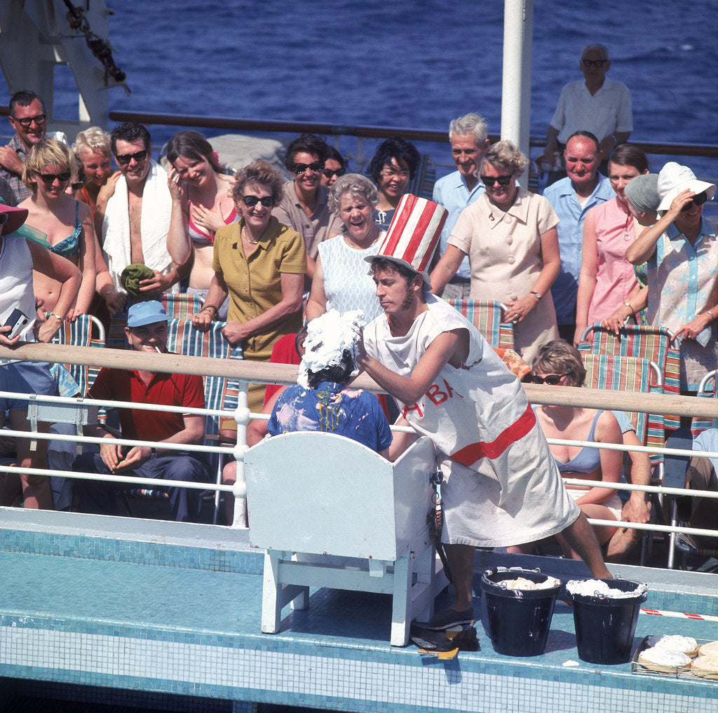 Detail of Comic hijinx aboard an unspecified cruise ship keeps the passengers entertained during the voyage - perhaps a variant of the Crossing the Line (the Equator) ceremony? by Marine Photo Service