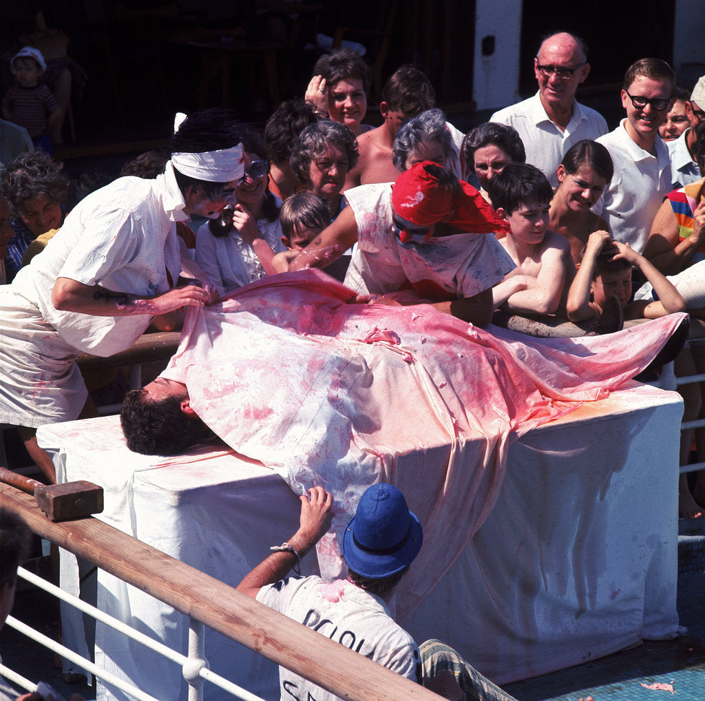 Detail of Macabre comic entertainment aboard an unspecified cruise ship - perhaps a variant of the Crossing the Line (the Equator) ceremony? by Marine Photo Service