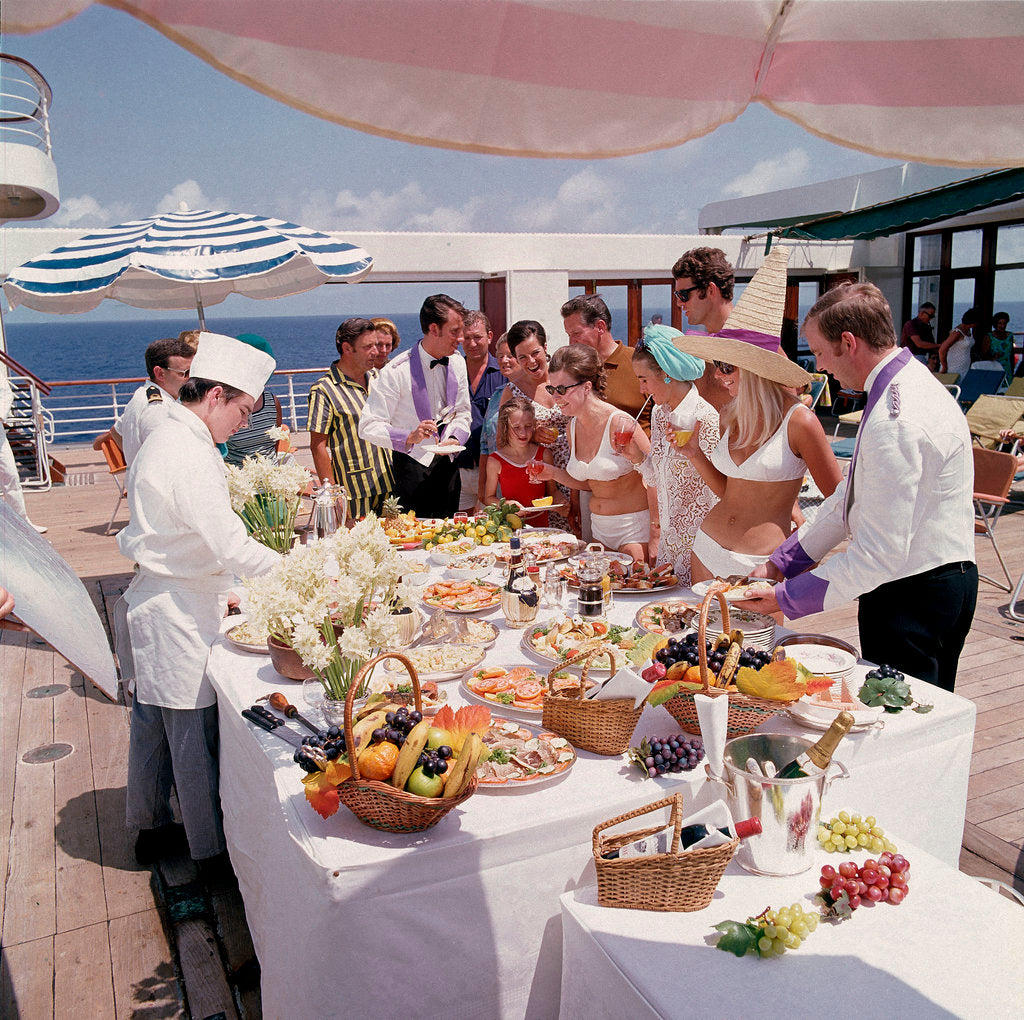 Detail of Fine weather allows passengers to enjoy a casual buffet on deck - no need to dress for dinner on this occasion! by Union Castle Line Collection