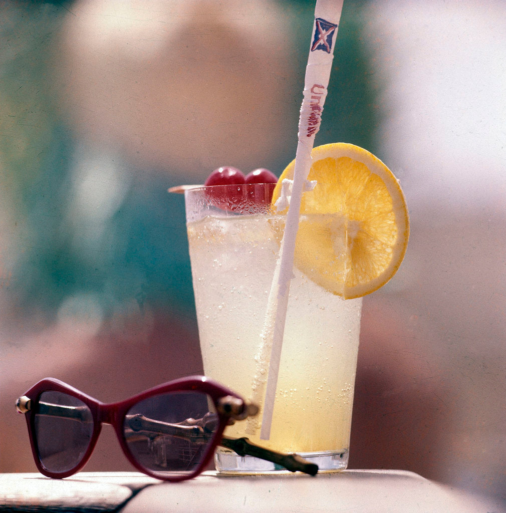 Detail of Cocktail and sunglasses aboard a Union-Castle cruise liner by Marine Photo Service