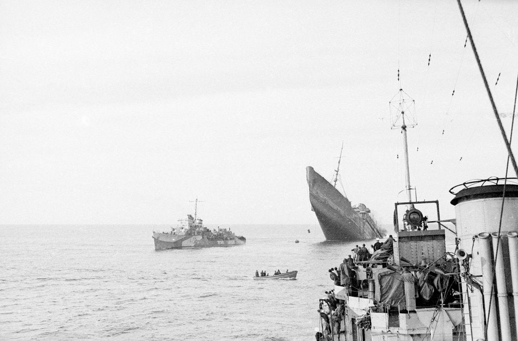 Photograph of Windsor Castle (1922) sinking in 1943,  distant port bow view with bow high in the air and escort destroyer 'Farndale' (1940) standing by 'Eskimo' in foreground by Lt JE Manners