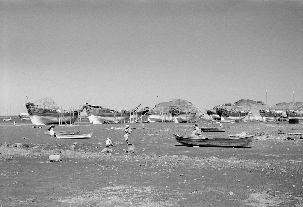 Detail of Booms and other dhows propped at low tide, Ma'alla beach by Alan Villiers
