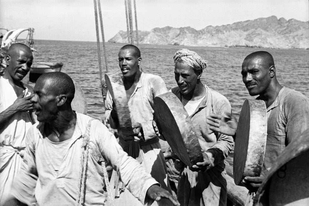 Detail of The musical crew of the 'Triumph of Righteousness' sailing into Mutrah Harbour, Oman by Alan Villiers