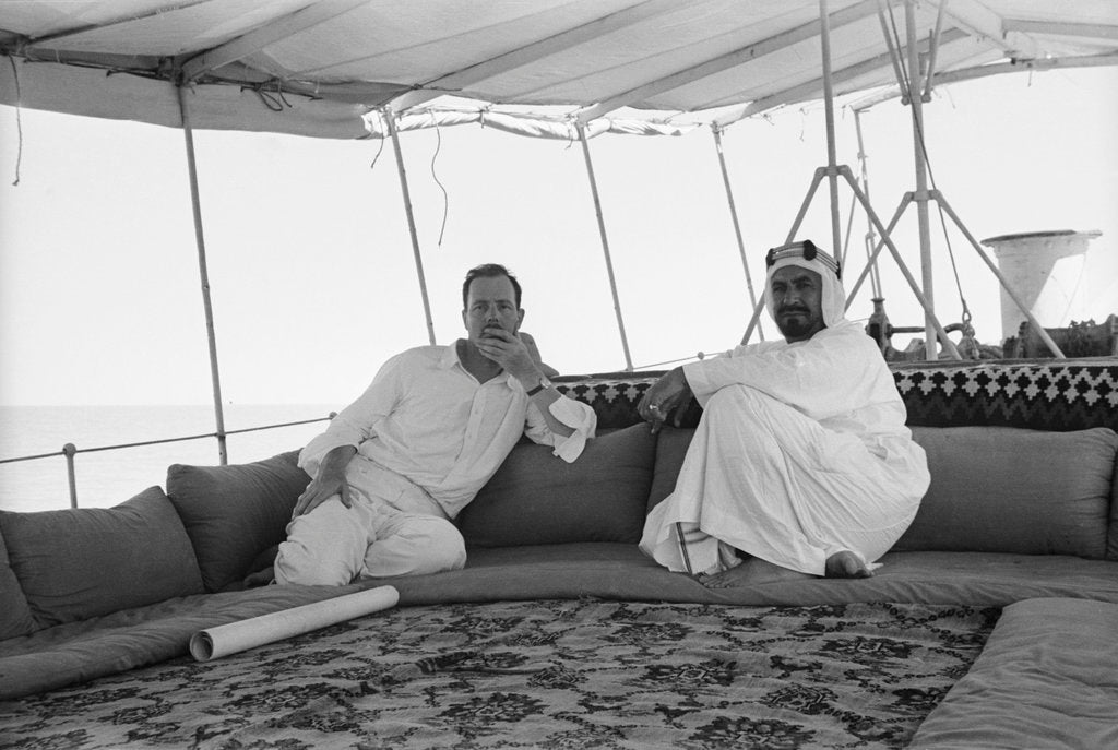 Detail of Sheikh Ahmad bin Jabir al-Sabah, Ruler of Kuwait, seated with the British Political Agent, Major A. C. Galloway by Alan Villiers