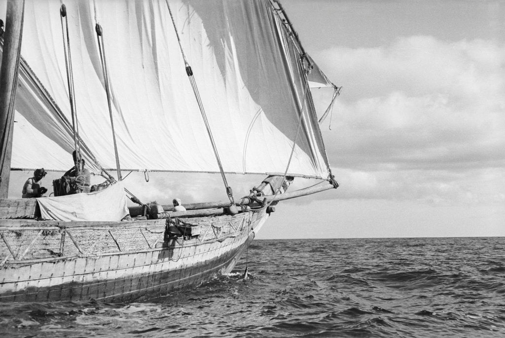 Detail of The tack of fore-foot of the mainsail with, behind it, a jib set on a spar, on a boom under full sail by Alan Villiers