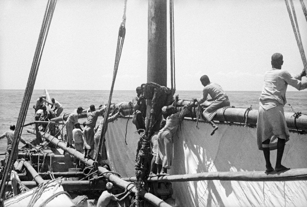 'Triumph of Righteousness' crew manoeuvring the mainsail by Alan Villiers