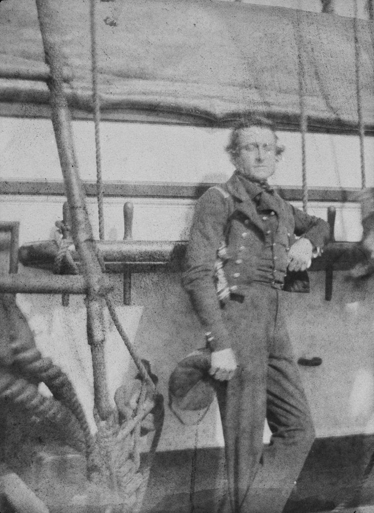 Detail of An unidentifed naval officer(?) standing by the belaying pin rail on the port side of the 80-gun three-decker HMS 'Superb' (1842). Inversed digital file to create b&w positive by William Henry Fox Talbot; Nicolaas Henneman